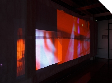 Holly Rowan Hesson, Echo (partial view), 2017, projection (looped series of 140 stills for each of six projectors), scaffold sheet, steel structure, webbing, lighting gels, dimensions variable (image credit: Jules Lister)